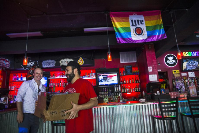 AUSTIN'S GAY BAR 'THE IRON BEAR'  WAS HIT AGAIN WITH FIREWORKS GETTING THROWN ON THEIR PATIO
